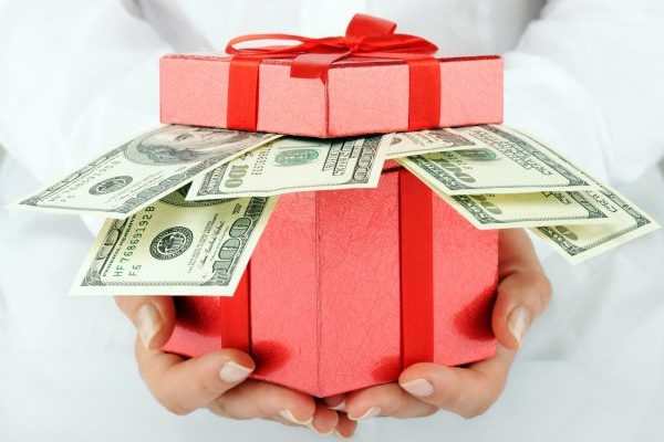 hands holding red box with dollars